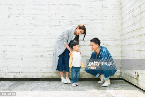 Young parents smiling at son
