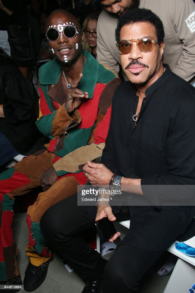 Young Paris and Lionel Richie sit in the front row at the Jeremy Scott fashion show during New York fashion week on September 8, 2017 in New York City.