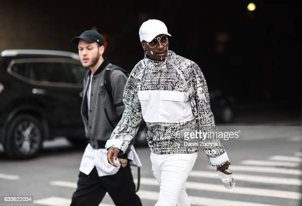 Young Paris is seen wearing a black and white jacket white hat and white tribal paint on the face outside of the General Idea show during New York...