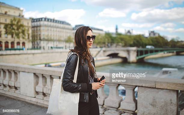 Young Parisian woman commuting