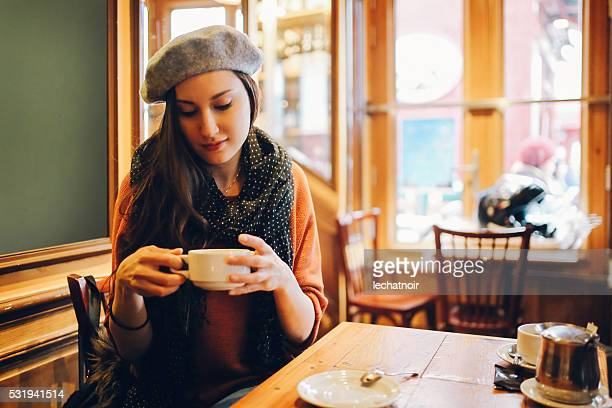 Young Parisian woman sitting in a cafe