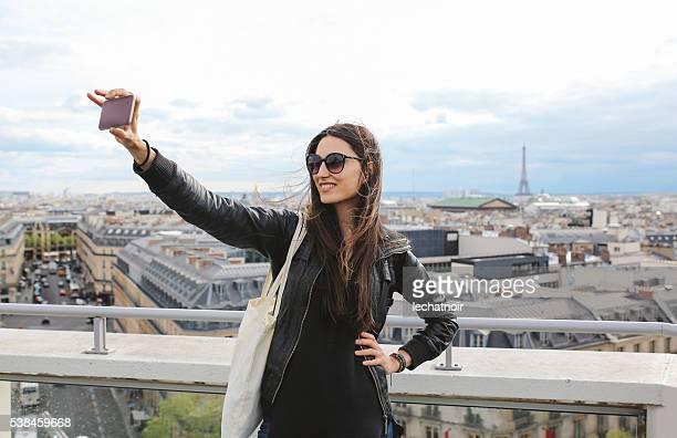 Young Parisian woman taking a selfie in Paris