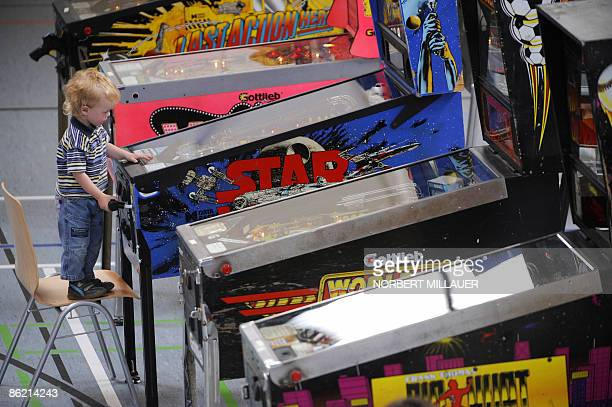 A young participant in the German pinball championships plays in the eastern German town of Wilsdruff on April 25 2009 AFP PHOTO DDP / NORBERT...
