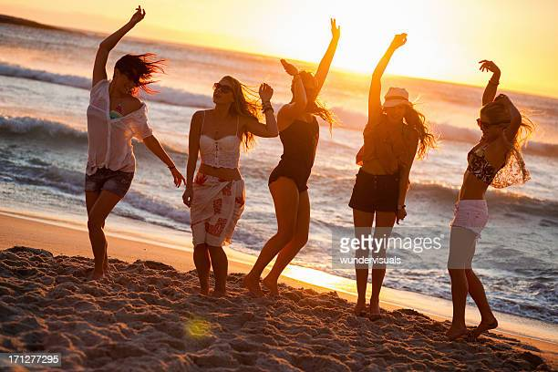 Young Party People dancing at the beach