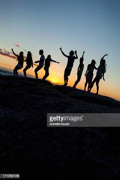 Young Party People Dancing On A Rock