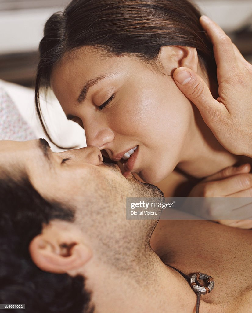 Young Passionate Couple With Their Eyes Closed Kissing : Stock Photo