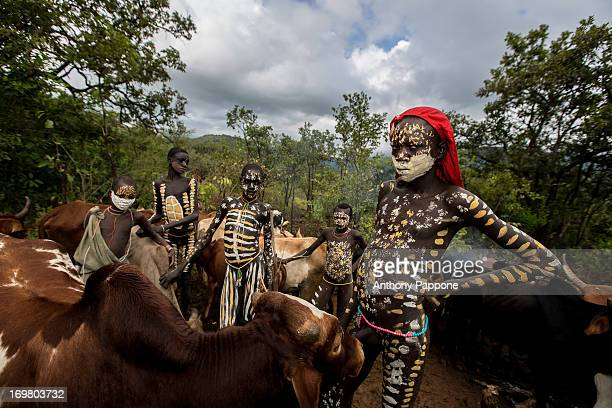 CONTENT] young pastors of the tribe surma with painted bodies