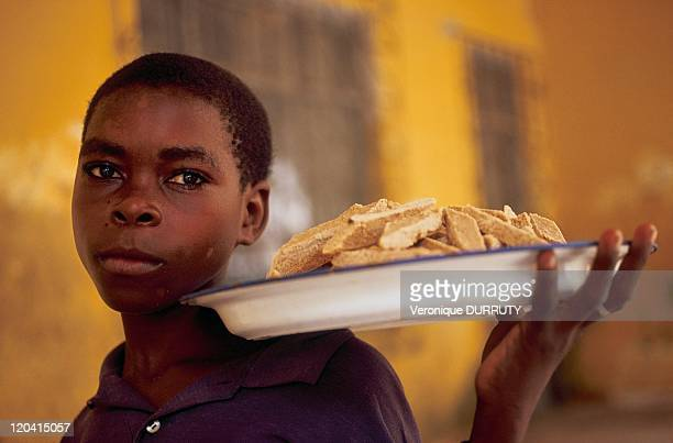 Young pastry seller in Mozambique