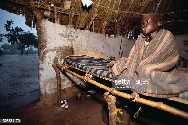 A young patient at the hospital in Ame Sudan suffers from malnutrition and malaria Civil war and widespread famine have ravaged Sudan for decades...
