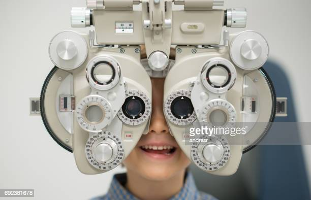 Young patient getting an eye exam at the optician