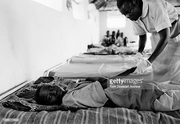 A young patient receives treatment at an MSF sleeping sickness clinic in Omugo Uganda This painful disease infects up to 500000 people and threatens...