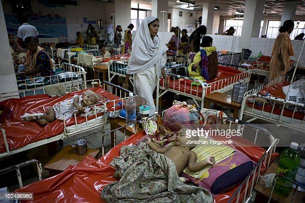 young patients at the ICDDRB Cholera Hospital in Dhaka Bangladesh on April 30 2006 In Kamalapur one of DhakaÕs largest slums water is gathered from...