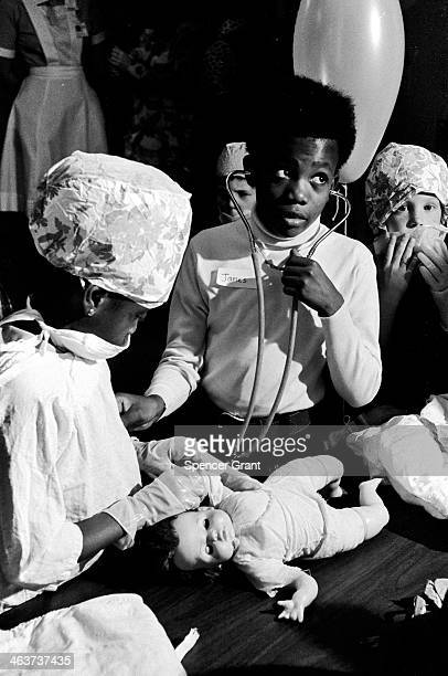 Young patients play with medical paraphernalia at 'preinduction party' at Boston Childrens Hospital Boston Massachusetts 1978