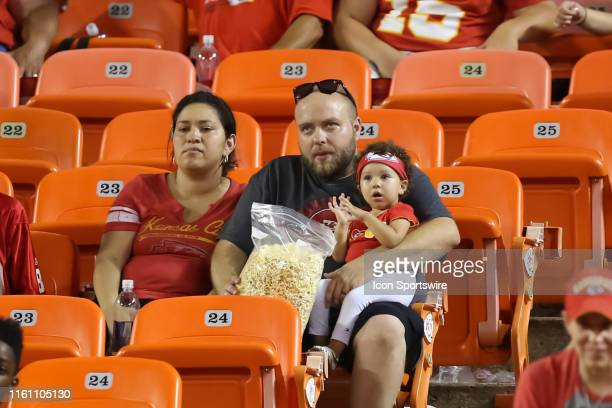 A young Patrick Mahomes fan sits with her parents during an NFL preseason game between the Cincinnati Bengals and Kansas City Chiefs on August 10...