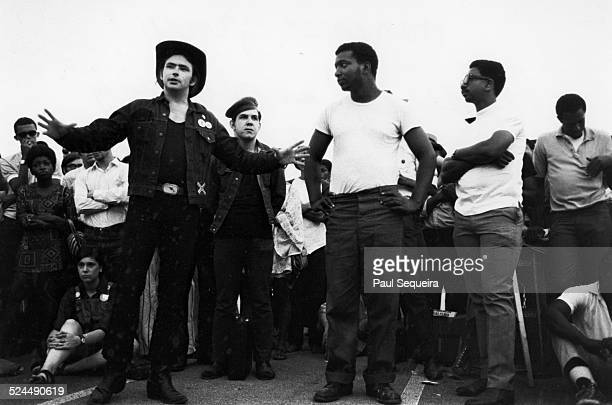 Young Patriots Organization leader Bill 'Preacherman' Fesperman Black Panther Party leaders Fred Hampton with arms akimbo and Bobby Rush with arms...