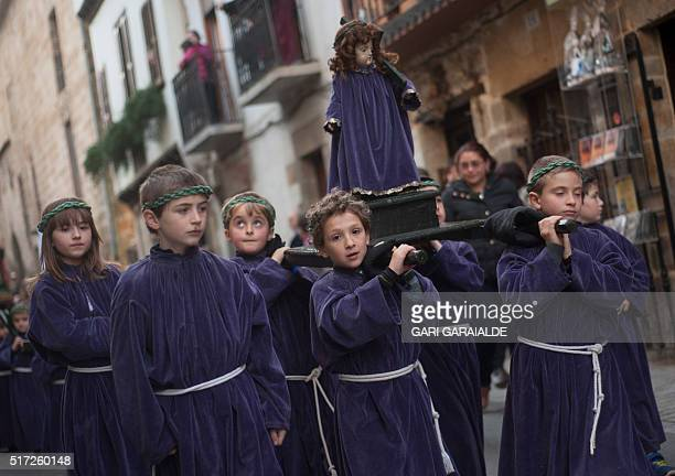 Young penitents carrying an effigy of Our Lady of Sorrow parade during a Holy Week procession in the northern Spanish Basque village of Segura on...