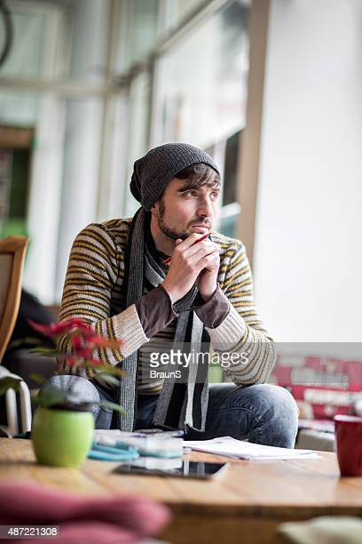 young pensive man having a creative block. - the_writer's_block stock pictures, royalty-free photos & images