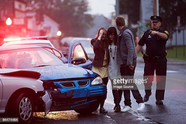 young people and police officer at scene of car crash - drinking and driving stock photos and pictures