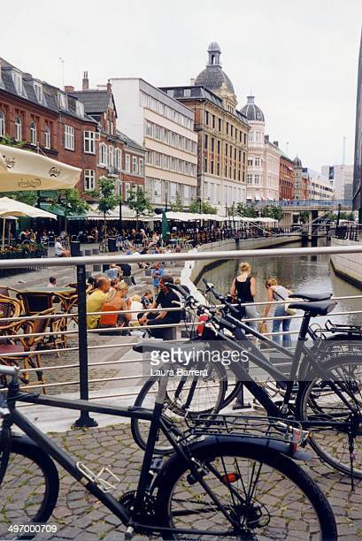 Young people and students having a coffee break along the Canal of Aarhus.