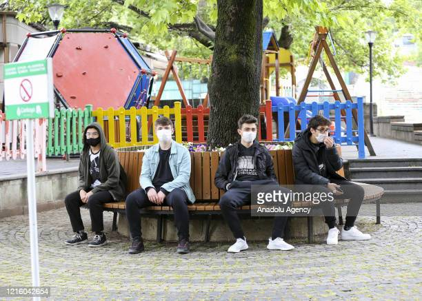 Young people are seen at a park after youths between 15-20 years across Turkey allowed to leave their homes, remaining within walking distance and...
