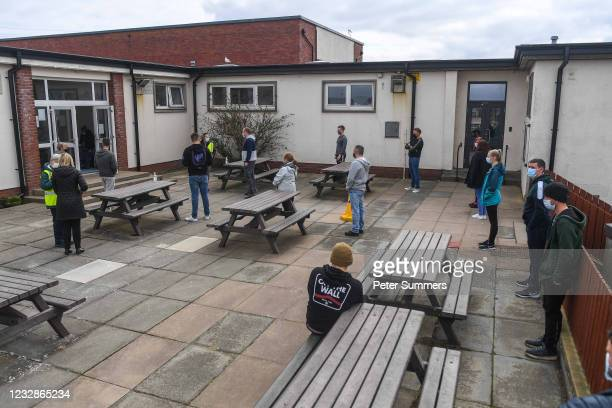 Young people are seen queuing outside a mobile vaccine unit on May 13, 2021 in Lossiemouth, Scotland. Scotland's First Minister Nicola Sturgeon has...