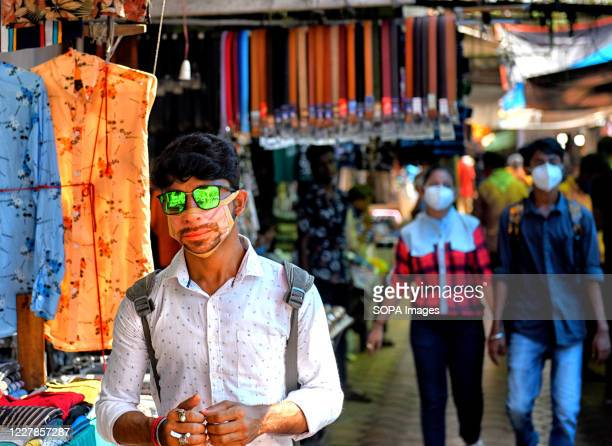Young people are seen wearing fashionable mask while shopping during the coronavirus crisis.