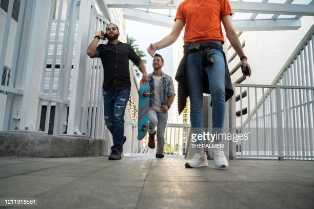 young people arriving at train station - puerto rican ethnicity stock pictures, royalty-free photos & images