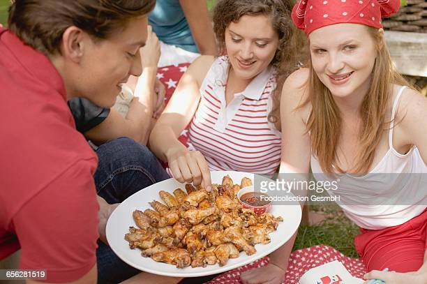 Young people at a 4th of July picnic