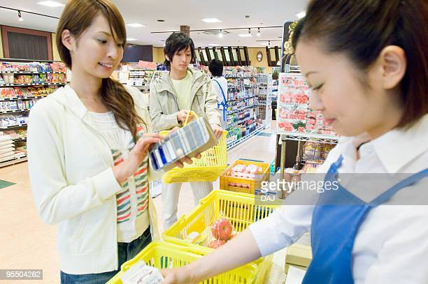 Young people at checkout counter