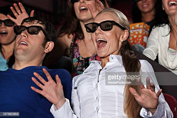 young people at the cinema with 3d glasses