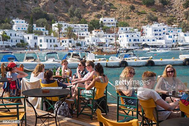 Young people at waterfront cafe, Loutro, Crete