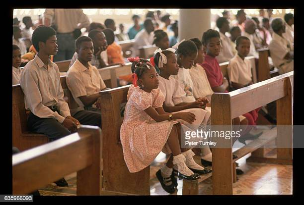 Young people attend a church service celebrating the return of exiled Haitian president Jean Bertrand Aristide