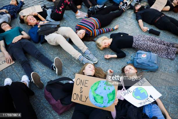 Young people attend 'Die-In' protest during Global Climate Strike to demand action be taken on climate change. Krakow, Poland 14 October, 2019.
