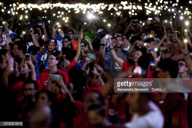 Young people attends a prayer vigil prayer celebrated by Pope Francis at Circus Maximus on August 11 2018 in Rome Italy Several thousands people...