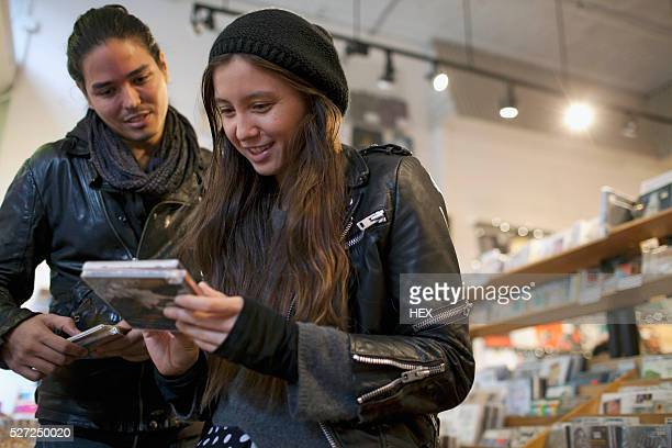 Young people browsing albums in a record store
