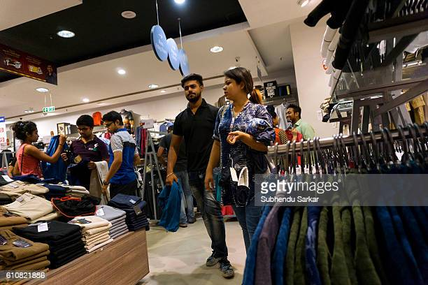 Young people buy garments of national and international brands at a big super market