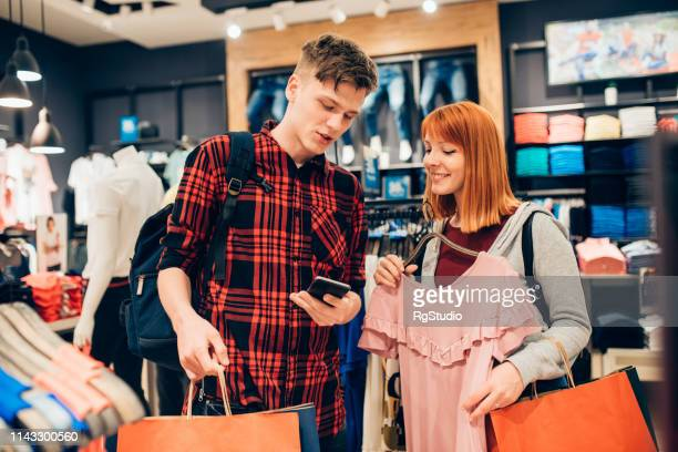 young people buying clothes - spending money stock pictures, royalty-free photos & images