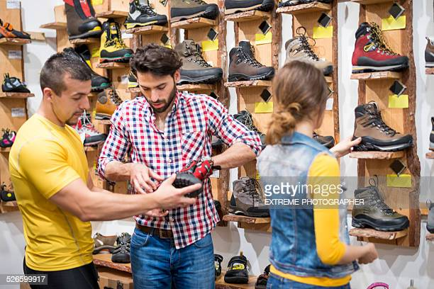 Young people buying hiking boots