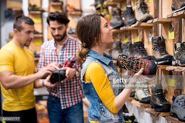 Young people buying hiking shoes