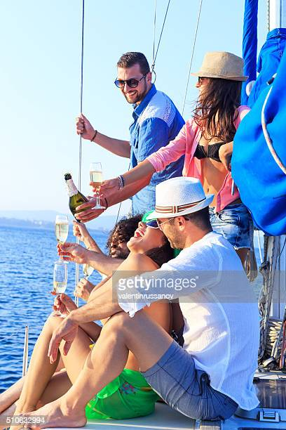 Young people celebrating during boat trip