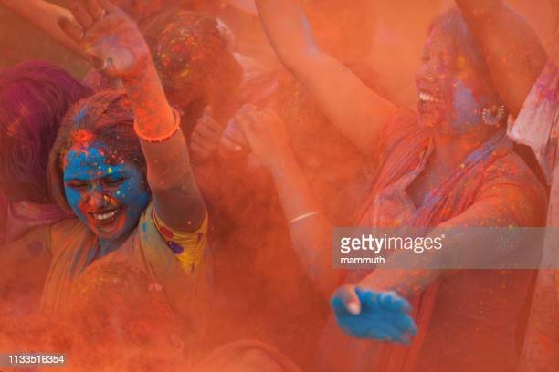 young people celebrating holi festival in india - tradition stock pictures, royalty-free photos & images