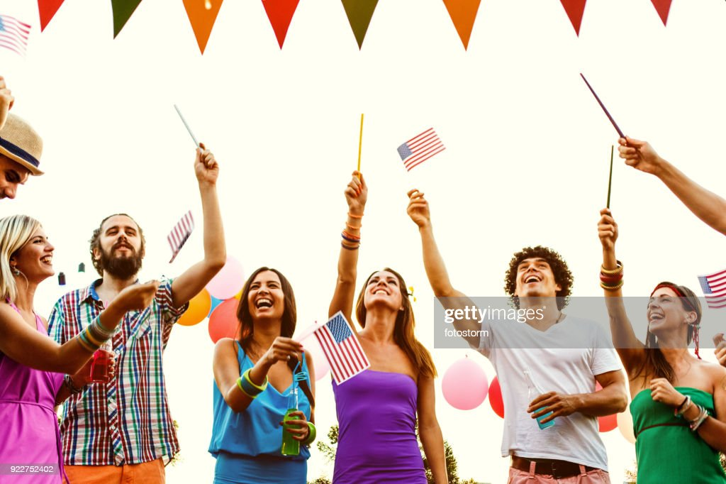 Young people celebrating Independence day : Stock Photo