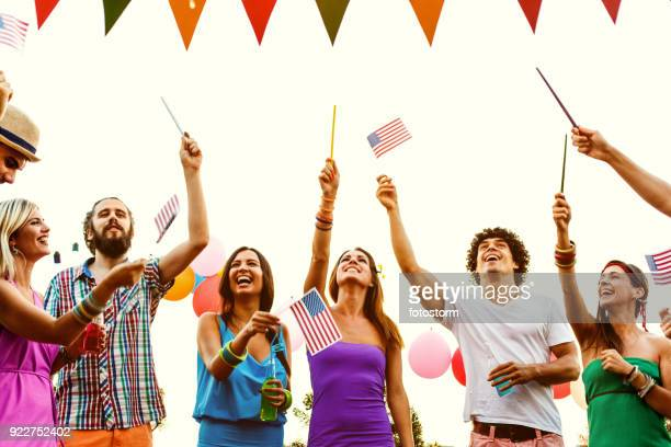 young people celebrating independence day - fourth of july stock pictures, royalty-free photos & images