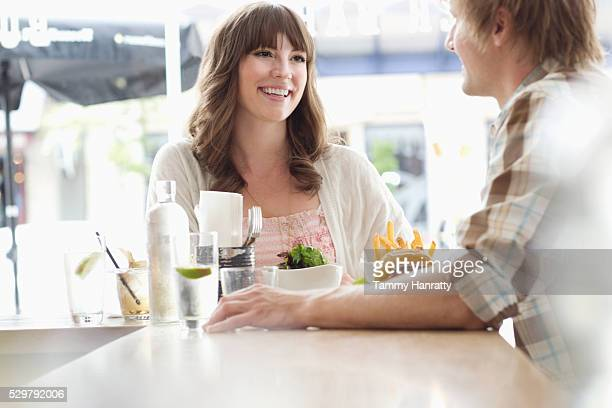 young people chatting in restaurant - tammy bar stock pictures, royalty-free photos & images