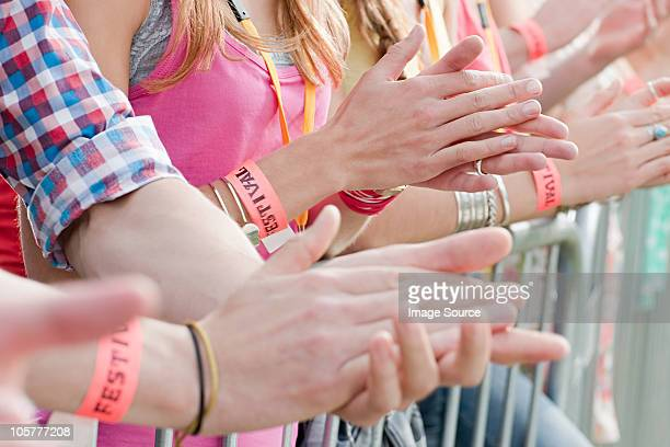 Young people clapping at festival, close up