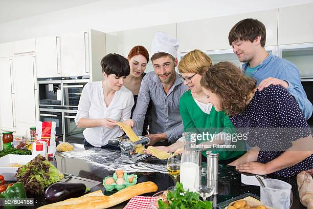 Young people cooking together