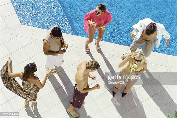 Young People Dancing at Pool Party
