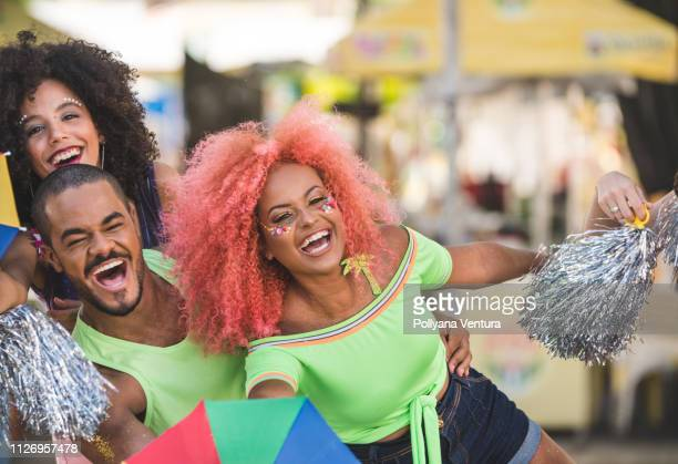 young people dancing at street carnival - parade stock pictures, royalty-free photos & images