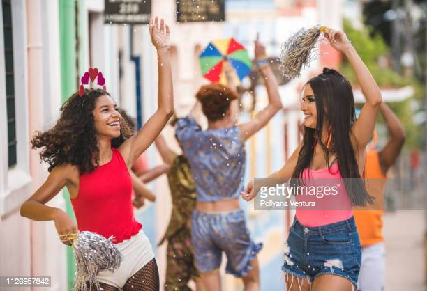 young people dancing at street carnival - samba stock pictures, royalty-free photos & images