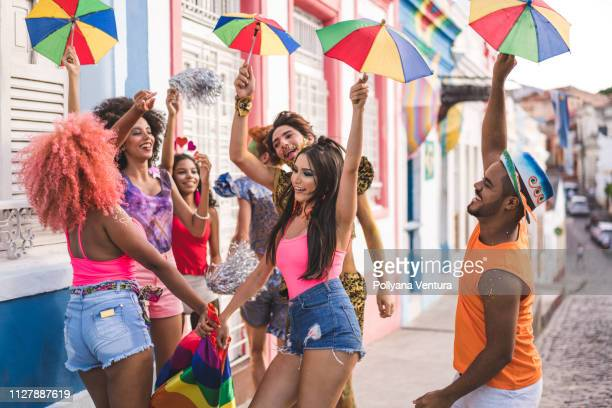 young people dancing at street carnival - recife stock pictures, royalty-free photos & images